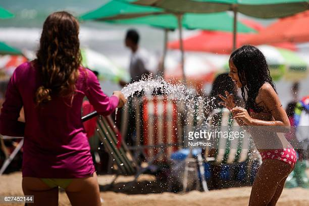 A child is seen while playing with water on Boa Viagem beach in Recife northeast Brazil December 03 2016