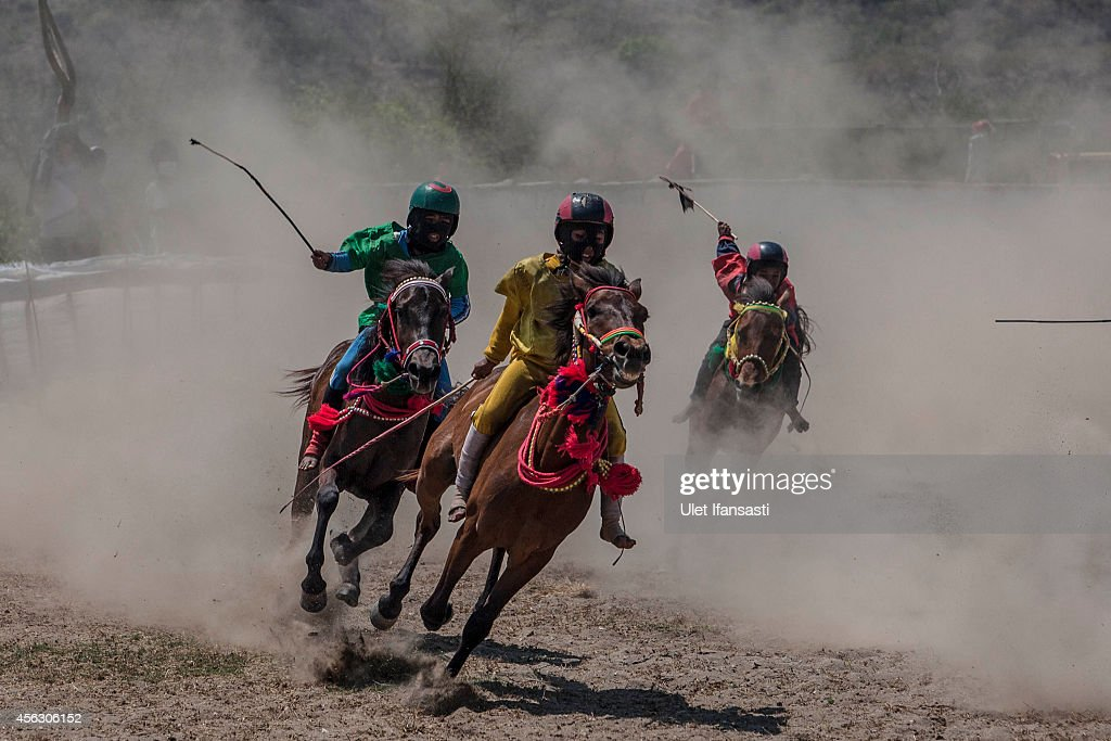 Child jockeys compete during the traditional horse races as part of Moyo festival on September 28 2014 in Sumbawa Island West Nusa Tenggara Indonesia...