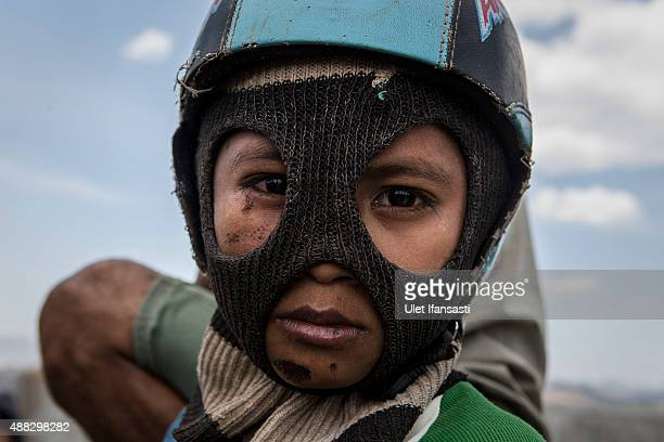 Child jockeys wait at the starting box as they prepare for the race during the traditional horse races as part of Moyo festival on September 15 2015...