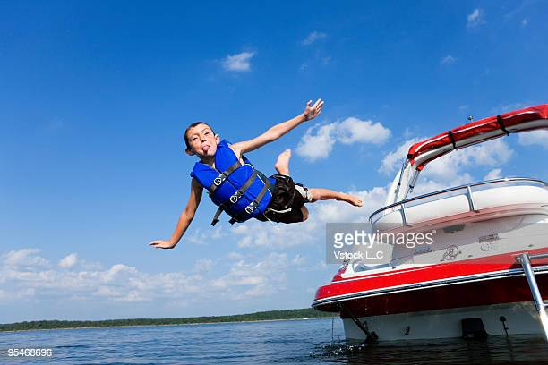 Child jumping off boat