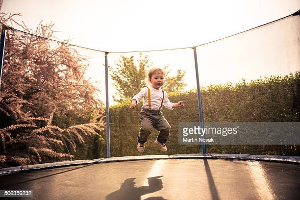 Child jumping trampoline