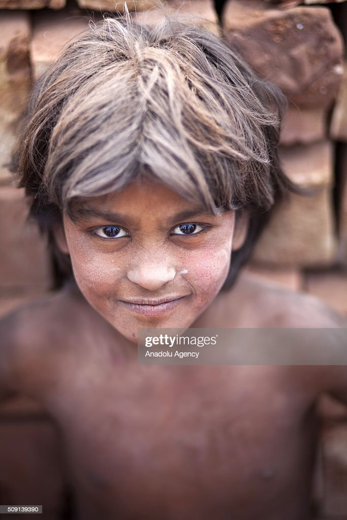 Child labor is seen near brick making field in Dhaka, Bangladesh on February 09, 2016. Despite of the hazardous effect of dust on health, child labor collect coal and sell it around $4 per a week to help their family budget. Child labor in Bangladesh is around 30.1%. Bangladesh adopted the National Child Labor Elimination Policy at 2010, providing a framework to eradicate all forms of child labor by 2015, but according to the International Labor Organization there are still around 3.2 million child labors in Bangladesh.