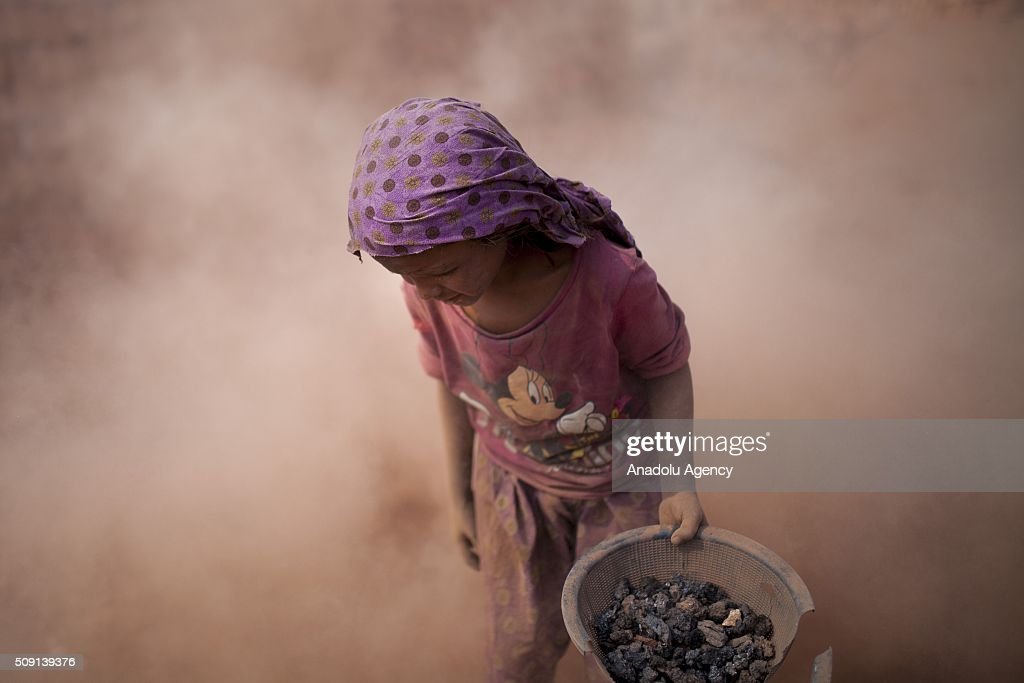Child labors collect coal from dust near brick making field in Dhaka, Bangladesh on February 09, 2016. Despite of the hazardous effect of dust on health, child labor collect coal and sell it around $4 per a week to help their family budget. Child labor in Bangladesh is around 30.1%. Bangladesh adopted the National Child Labor Elimination Policy at 2010, providing a framework to eradicate all forms of child labor by 2015, but according to the International Labor Organization there are still around 3.2 million child labors in Bangladesh.