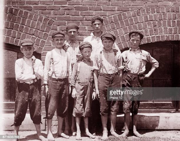 Child labour in early twentieth century USA Doffer boys in Aragon Mills Rock Hill South Carolina photographed by Lewis Hine on 13 May 1912