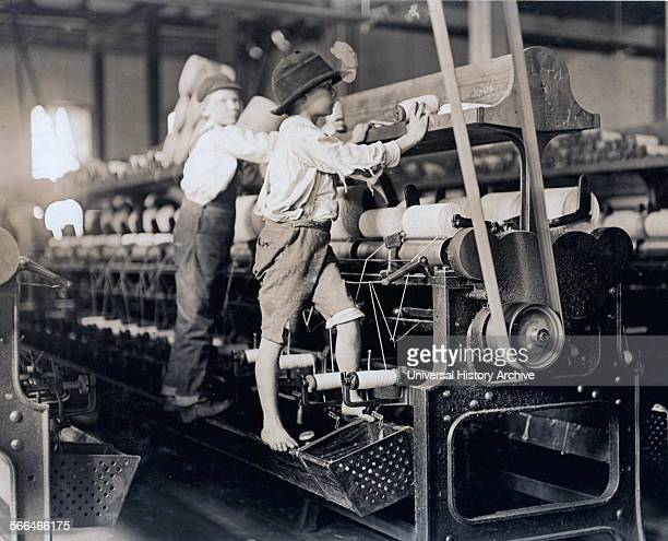 Child labour in the USA 1909 Bibb Mill No 1 Many youngsters here Some boys were so small they had to climb up on the spinning frame to mend the...
