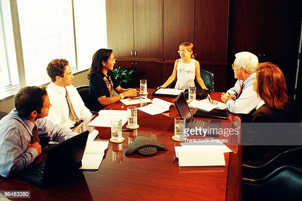 Child leading business meeting