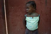 A child leans against a wall at the Croix Glorieuse orphanage in PortauPrince on January 29 2010 Quakehit Haiti will need at least a decade of...