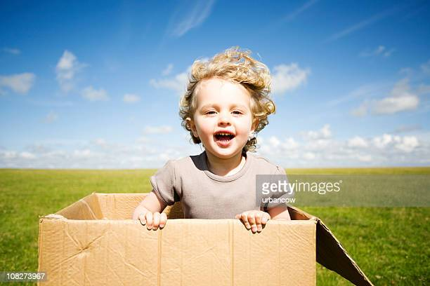 Child leaping out of a box