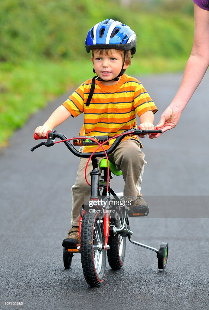Child learning to ride a bike : Stock Photo