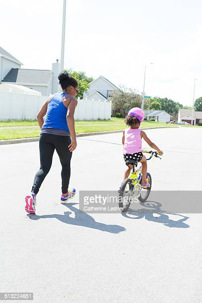 Child learning to ride a two wheeled bike