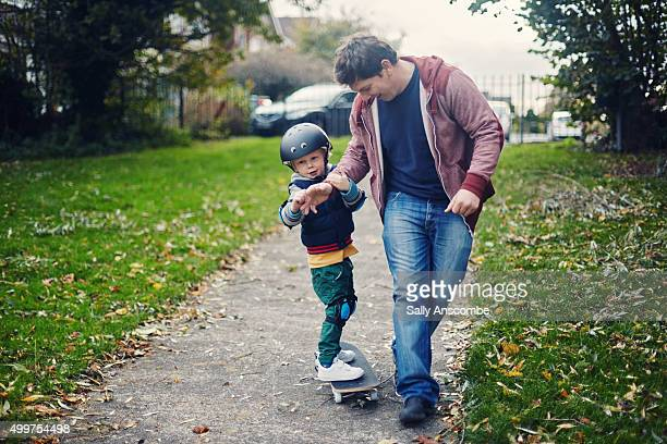Child learning to skateboard