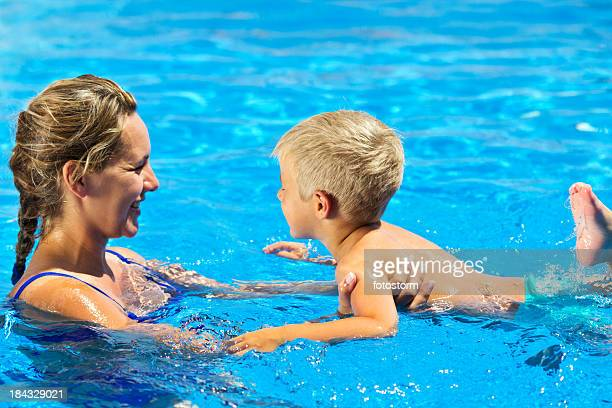 Child Learning To Swim