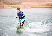 Child learning to wakeboard
