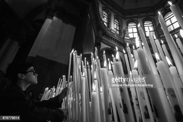 A child lights a candle to thank the Virgin Mary inside the Church of Santa Maria della Salute the day before the Festa della Salute on November 20...