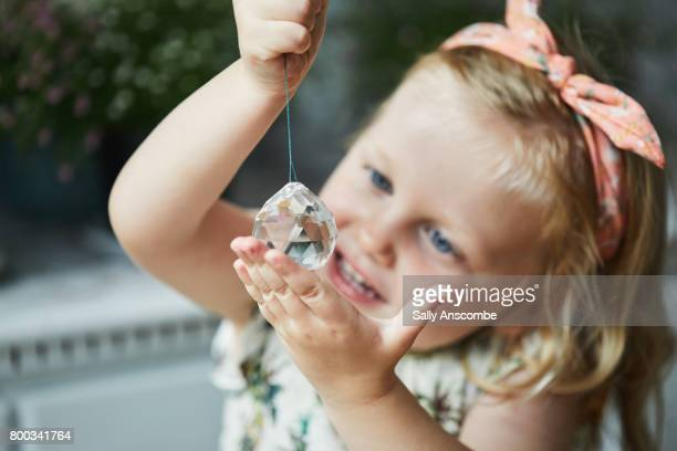Child looking at a crystal
