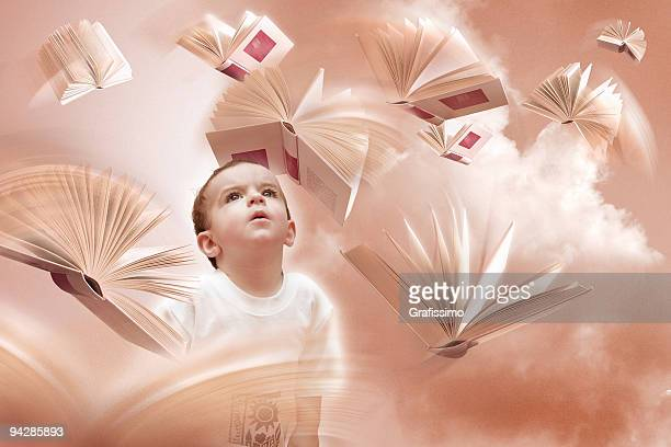 Child looking at flying books