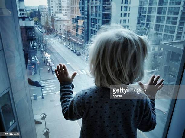 Child looking at street from above