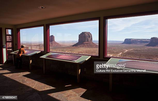 Child looking out from viewing platform at The Mittens, Monument Valley, Navajo Tribal Park, Arizona, USA
