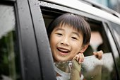 Child Looking Out of Automobile Window