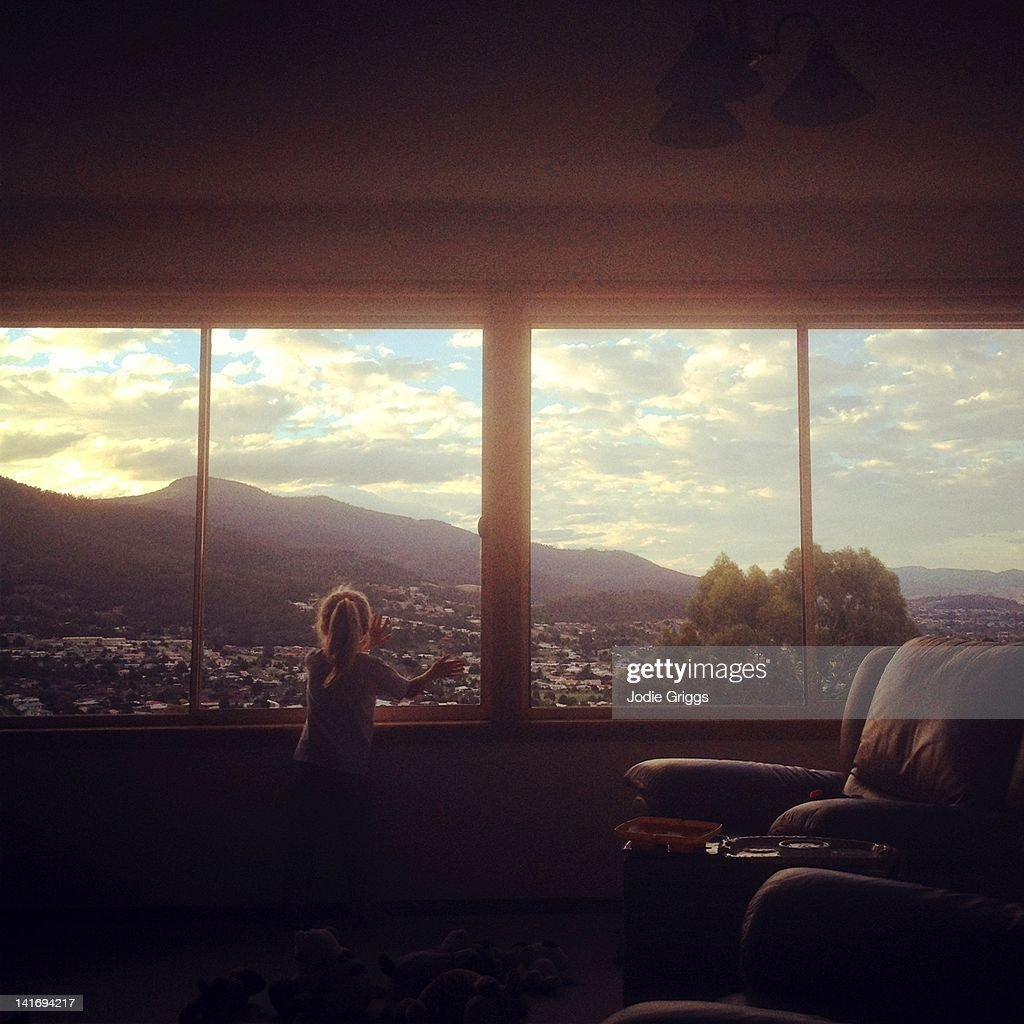 Child looking out of window : Stock Photo