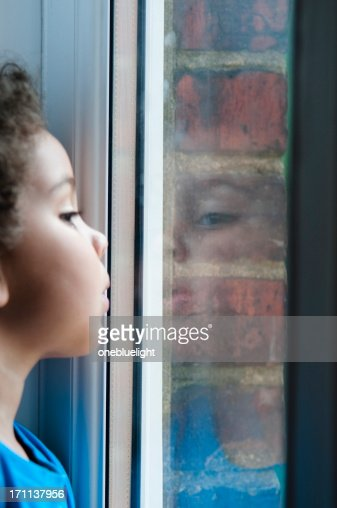 child looking through window. child looking through window : stock photo r