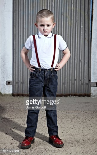 Child looking to camera with attitude. : Stock Photo