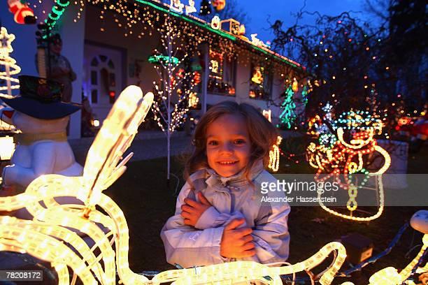 Child looks at Christmas Illumination in a garden on December 2 2007 in Schwaig near Munich Airport Germany