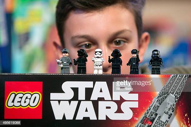 A child looks at Lego figurines from the Star Wars 'Kylo Ren's Command Shuttle' manufactured by Lego A/S as it sits on display at the Toy Retailers...