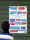 A child looks at the chart on secularism in school on December 9 2014 at the Louis Aragon school in the northern Paris suburb of Pantin on National...