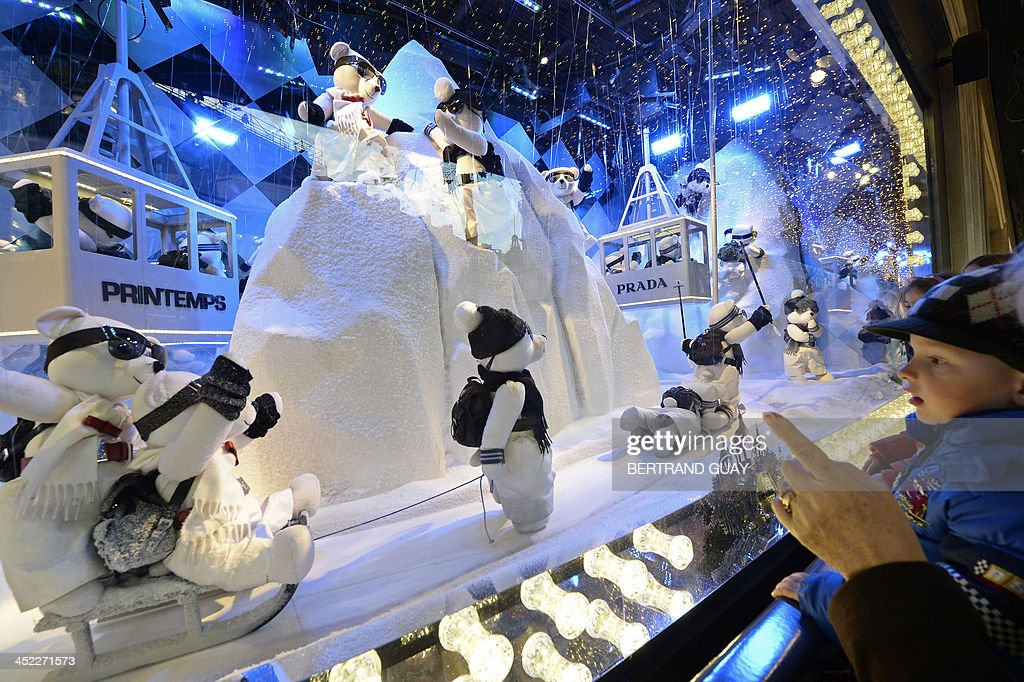 A child looks at toy exhibited in the Christmas windows of Paris department store 'Printemps' on November 27, 2013.