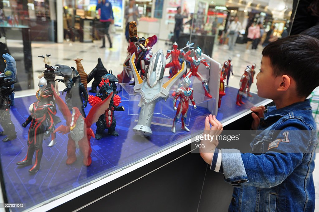 A child looks small Ultraman models displayed in a shopping mall on May 3, 2016 in Shanghai, China. As part of an exhibition commemorating 50th anniversary of Ultraman, the exhibition is the largest official exhibition of Ultraman in China.