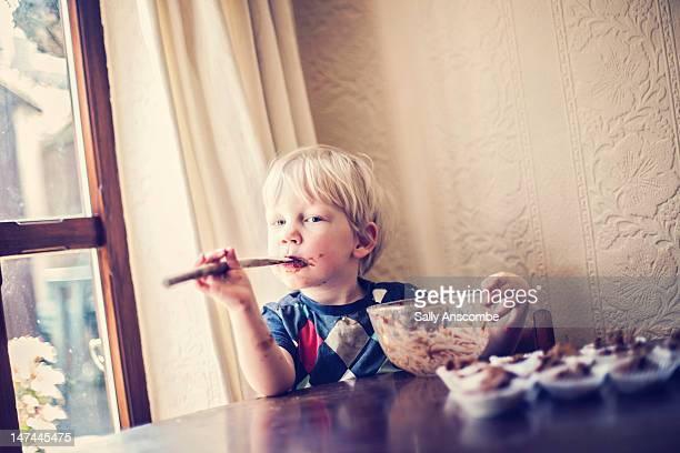 Child making chocolate cakes