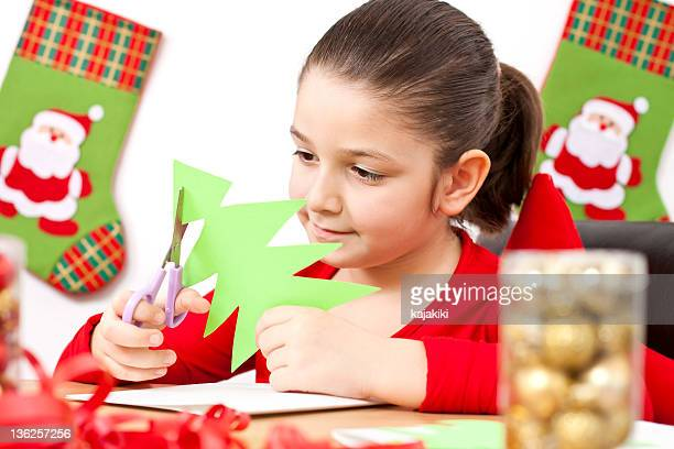 Child making decoration for Christmas
