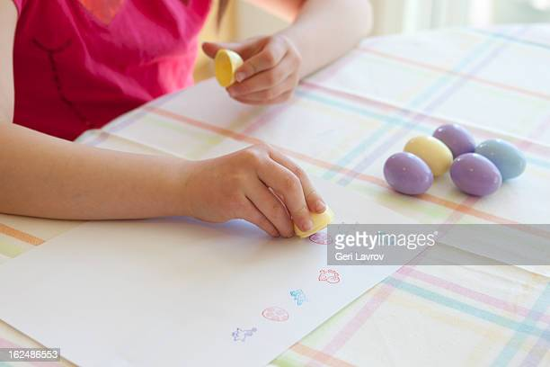Child making Easter cards