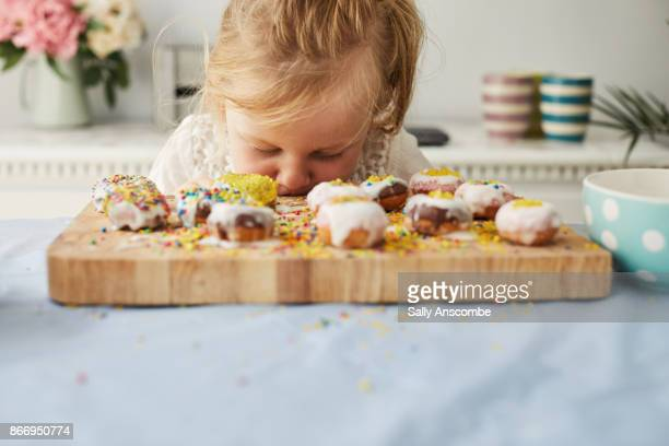 Child making iced doughnuts