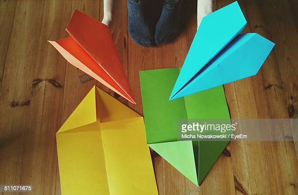 Child making paper aeroplane