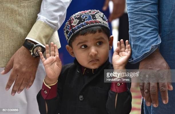 A child offers prayer on the occasion of EidUlFitr at Quddus Saheb Eidgah on June 26 2017 in Bengaluru India The celebrations marked the end of Holy...