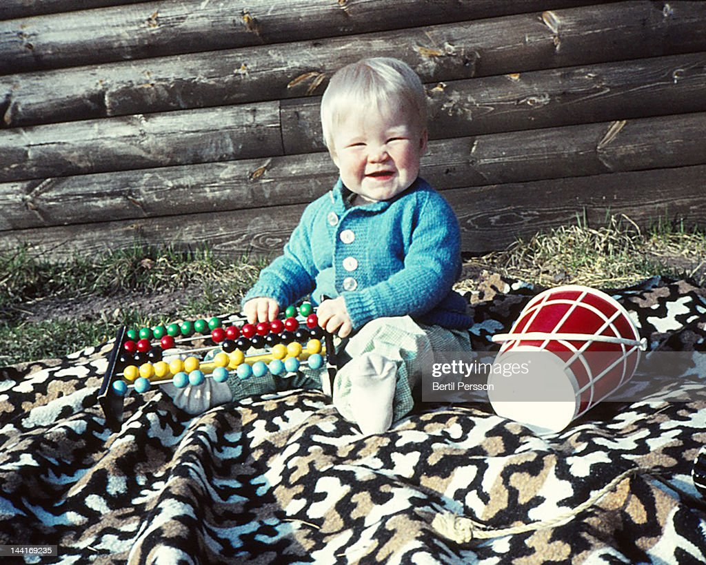 Child on blanket  with abacus : Stock Photo