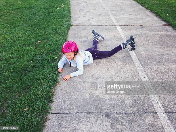 Child on ground after falling over inline skates