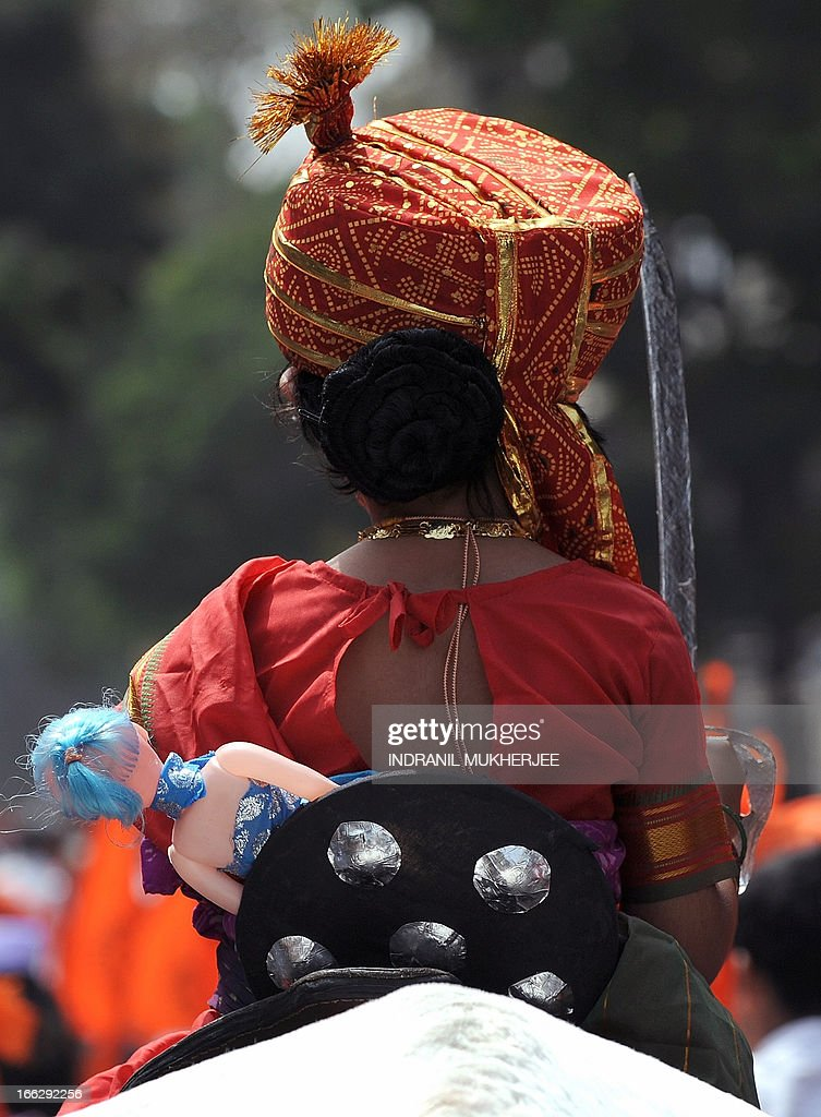 A child on horseback, dressed as legendary Indian warrior Queen Laxmibai, carries her doll during a procession on 'Gudi Padwa' or the Maharashtrian new year in Mumbai on April 11, 2013. Gudi Padwa is the Hindu new year for the people of India's state of Maharashtra, that falls on the first day of the month of Chaitra according to the lunar calendar and is celebrated by dancing and singing. Gudi Padwa also marks the end of the harvest and the beginning of the new season.