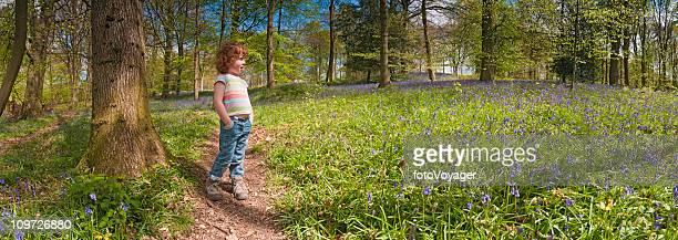 Child on idyllic forest trail panoramic wilderness