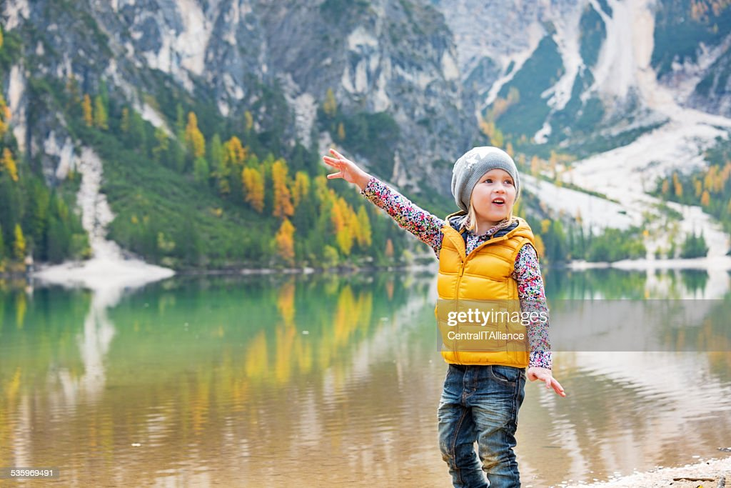 Child  on lake braies in south tyrol, italy : Stock Photo