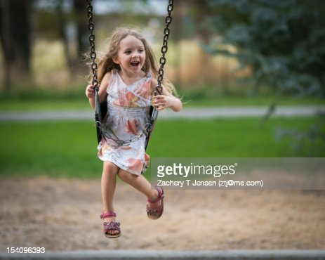 Child on swing : Stock Photo