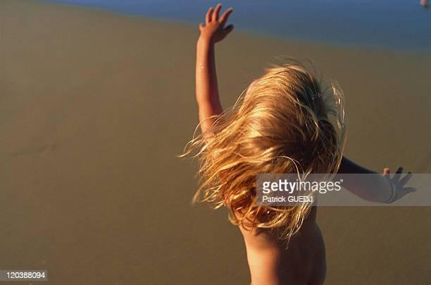 Child on the beach in Australia Book 'Fleur de peau' p130