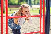 Children playground. Cute little girl having fun in the park