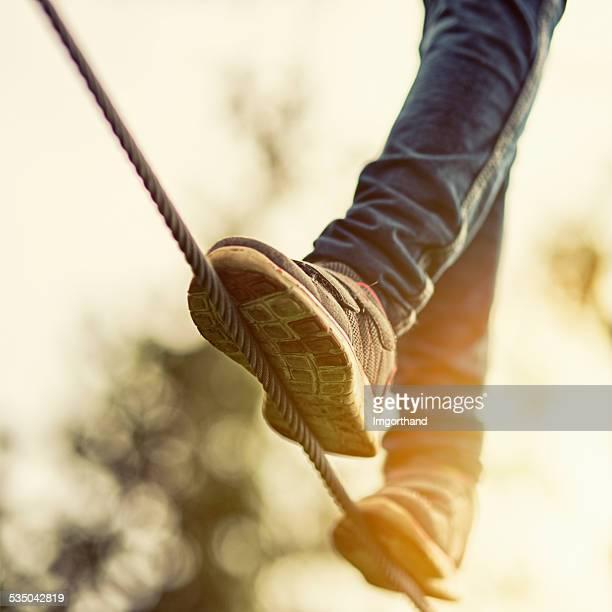 Kind auf zip line in adventure park