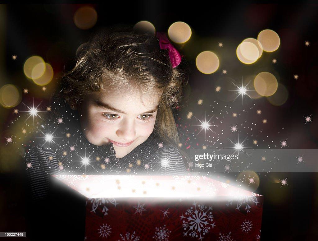Child opening a magic box
