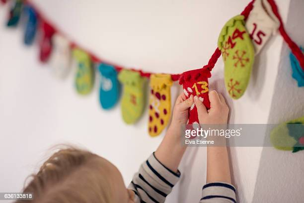 Child opening advent calendar