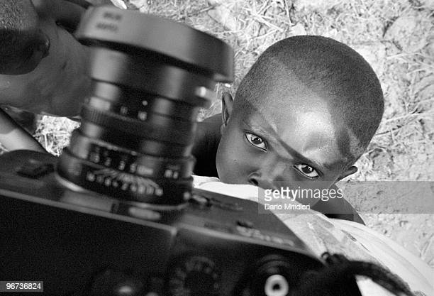 A child orphaned during the 1994 Rwandan genocide is looking at photographer Dario Mitidieri in one of the refugee camps set up around the city of...