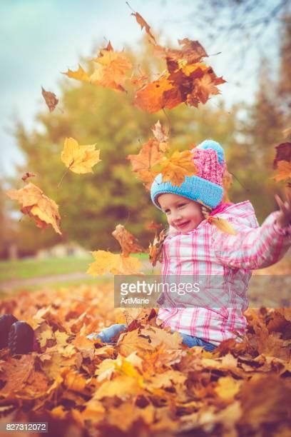 Child outdoors in autumn